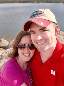 Becky Baruth with husband at mountain lake
