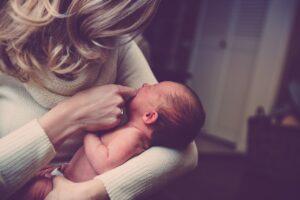 newborn crying mother